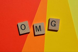 OMG, acronym for Oh My God, used as internet slang in text speak