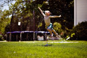 Playing in the sprinklers, flying in the sky