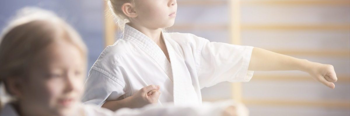 Girl in kimono practicing karate