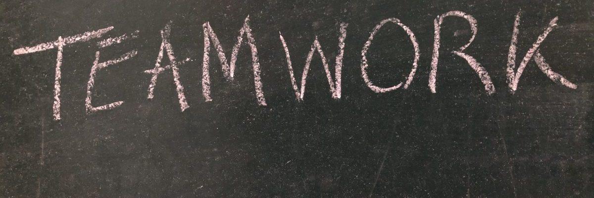 Teamwork, word on a chalkboard
